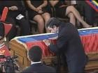 Mahmoud Ahmadinejad, kisses the coffin of Hugo Chavez - 08/03/2013
