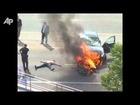 Raw Video: Burning Car Lifted Off Trapped Man